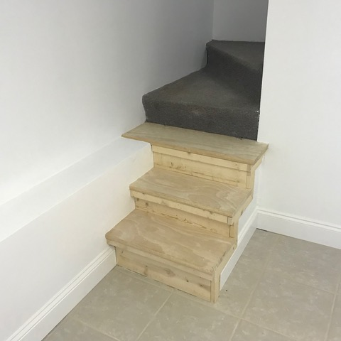 Homeowner built stairway extension looks jury-rigged! Do-it-yourself additions.